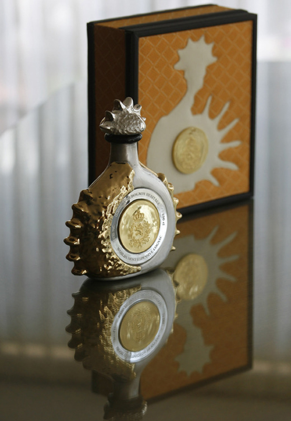 "A bottle of 100 numbered handcrafted Crystal Liquor bottles named ""Henri IV…Gold & Silver"", dipped in Yellow Gold and Sterling Silver, is seen during a presentation in Mexico City"