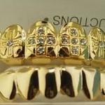 Grillz, dientes con oro y pedrería