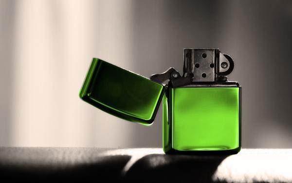 green-zippo-lighter-close-up-photo