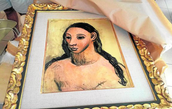 "(FILES) A handout picture taken on July 31, 2015 and released on August 3, 2015 by the French Customs office, shows the seized painting 'Head of a young woman' by famous Spanish painter Picasso, at the Customs offices in Calvi. A Picasso worth 25 million euros (27.4 million USD) and considered a cultural treasure by Spanish authorities who had barred it from being exported was seized from a boat owned by Spanish Santander banking group and docked at Corsica, French authorities said August 4. The owner of the painting, Spanish banker Jaime Botin, suspected of attempting to illegally export the artwork seized by French customs, argues that the painting is not Spanish but British, his lawyers said in a statement on August 7, 2015. AFP PHOTO / FRENCH CUSTOMS OFFICE  RESTRICTED TO EDITORIAL USE - MANDATORY CREDIT "" AFP PHOTO / FRENCH CUSTOMS OFFICE "" - NO MARKETING NO ADVERTISING CAMPAIGNS - DISTRIBUTED AS A SERVICE TO CLIENTS - TO ILLUSTRATE THE NEWS STORY AS SPECIFIED IN THE CAPTION"