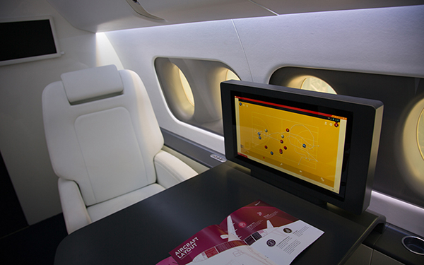 The Sukhoi SportJet features a table and monitor where team coaches can sit and share plays, strategies and team footage with the athletes. A full-scale model of the plane's interior was on display at the Marimbas Club in Rio de Janeiro, Brazil, Sunday, Aug. 7, 2016. (Photo by Graham Bosch/Cronkite News)