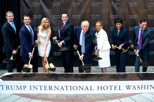 The Trump Family, including Donald J. Trump, Donald Trump Jr., Ivanka Trump and Eric Trump, is joined by local dignitaries, including, Congresswoman Eleanor Holmes Norton, Mayor Vincent Gray, D.C. Councilmember Muriel Bowser, and Dan Tangherlini, Administrator of the United States General Services Administration, to break ground on Trump International Hotel, Washington, D.C., at the Old Post Office building on July 23, 2014. The Trump Organization's $200 million redevelopment of the iconic building includes 270 Luxury Guestrooms, Presidential Suites, the Largest Luxury Ballroom in D.C., World-Class Restaurants and Retail, and Luxury Spa. Photo by Tim Lundin | Freelance | tim@TDLphoto.com - http://TDLphoto.com